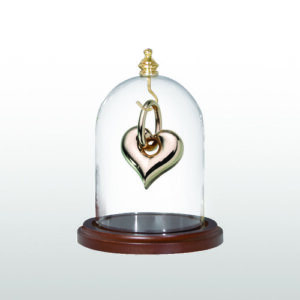Cremation jewelry can be displayed in a jewelry dome rather than worn