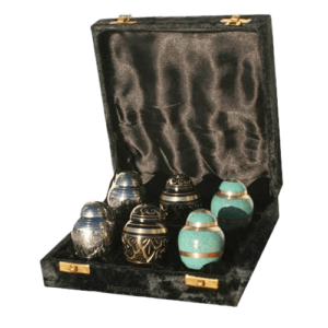 Keepsake urns hold a small amount of cremation ashes for families who are scattering or sharing the remains.